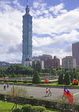 Taipei 101 building seen from Sun Yat-sen Memorial Hall decorated with Republic of China flags.