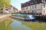 Sightseeing boat on canal in Strasbourg, France.