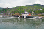 Viking River Cruises long ship Baldur on middle Rhine River passing Maus Castle in the river.