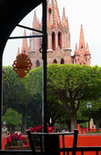 View from restaurant window of Jardin and La Parroquia Cathedral in San Miguel de Allande, Mexico.