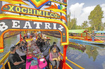 Tourists after finishing lunch on board their trajinara cruising the floating gardens of Xochimilco at Mexico city.