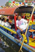 Boatman on trajinara of Mariachi band at Xochimilco in Mexico City.