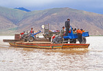 Tibetan farmers on ferry crossing Yarlung Zangbo (Tsangpo) River between Lhasa and Shigatze (Shigatse), Tibet.