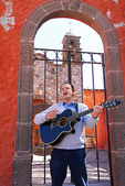 Singer/song writer Jean Pascal Monzies with guitar in San Miguel de Allende, Mexico.