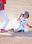 Slide at 3rd base, youth baseball game