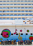 Luggage to load at Port of Miami on Norwegian Breakaway decorated by Peter Max.
