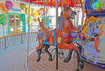 Carousel and Sugar Beach candy shop on Boardwalk of Royal Caribbean's Symphony of the Seas cruise ship.