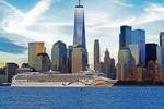 Norwegian Dawn cruise ship in New Yrk Harbor passing Manhattan skyline with One World Trade Center