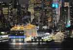 Cruise ships MSC Meraviglia and Silversea's Silver Wind at the Manhattan Cruise Terminal in New York at night.