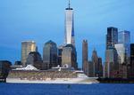 Oceania cruise ship Riviera passing lower Manhattan skyline on Hudson River at New York Harbor.