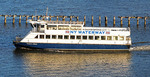 NY Waterway ferry on Hudson River at New York Harbor traveling from Manhattan to New Jersey.
