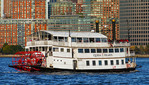 Queen of Hearts sightseeing tour boat with imitation paddle wheel on Hudson River/New York Harbor at lower Manhattan.