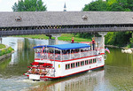 Bavarian Belle Riverboat on sightseeing cruise of Cass River at the Frankenmuth wooden covered bridge.