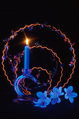 Blue candle with flame