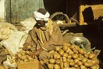 Aswan Market, potato seller, Egypt