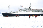 People On Ice With Ship, Antarctica