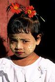 Girl with thanaka on face, Yangon, Burma