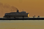 SS Badger At Sunset Along Breakwater With People, Ludington, Michigan