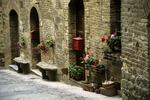 San Gimignano Street with Flowers and Mailboxes, San Gimignano, Italy