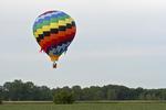 Rainbow Hot Air Balloon Floating Over Field, Seymour, Wisconsin
