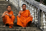 Monks on steps of temple, Thaton, Thailand