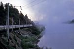 Trans-Siberian Railway along lake with fog, Siberia, Russia
