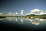 Sepik River with Boat and Clouds, Papua New Guinea