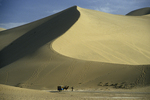 Mingsha Sand Dune with Man and Camel and Cart, Dunhuang, China