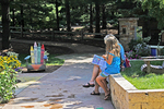 Reading at the Bookworm Gardens, Sheboygan, Wisconsin