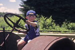 Aaron Driving Tractor at Logging Camp #5, Laona, Wisconsin