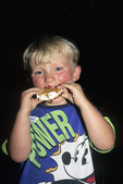 Aaron Eating S'Mores by Camp Fire, Three Lakes, Wisconsin