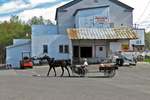 Amish Farmer with Wagon and Horse at Jaster's Ag Supply, Kingston, Green Lake County, Wisconsin