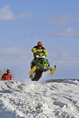 Snocross Snowmobilers Racing in Winter at Gravity Park, Chilton, Wisconsin