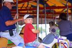Riding the Carousel at Bay Beach Amusement Park, Green Bay, Wisconsin