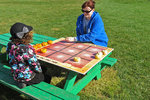 Playing Pumpkin Tic-Tac-Toe, Meuer Farm, Chilton, Wisconsin