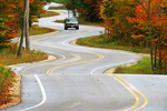 Curvy Road and Car in Fall on Hwy. 42 to Northport, Door County, Wisconsin