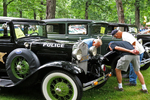 Looking at 1931 Ford Police Car, Appleton Old Car Show and Swap Meet, Appleton, Wisconsin