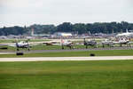 US Navy Warbird Planes Landing, EAA, Air Venture Show, Oshkosh, Wisconsin