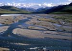 Kongakut River, a braided river, flows out of the Brooks Range at Caribou Pass in summer.
