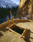 Ladder and kiva entrance in Ceremonial Cave, Anasazi culture site, 150 feet above floor of Frijoles Canyon. Bandelier National Monument, New Mexico.