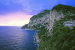 Island of Capri[Isola di Capri] with clearing storm at sunset.  Mediterranean Sea.  Near the Amalifi Coast.  Campania, Italy