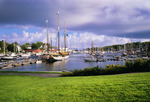 Camden Harbor in summer with historic schooners [windjammers] at dock.  Knox County.  Maine.