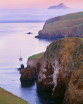 Sunset at Little Scorpion Anchorage, Santa Cruz Island, with Anacapa Island and fog bank in distance.  Channel Islands National Park, California.
