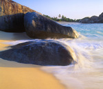 Granite boulders form The Baths at sunset. Virgin Gorda Island. British Virgin Islands. Caribbean.