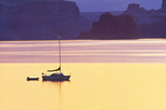 Sailboat at anchor at dawn. Padre Bay, Lake Powell. Glen Canyon National Recreation Area, Arizona.