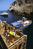 Landing Cove, with boats [loading and unloading passengers].  East Anacapa Island.  Channel Islands National Park, California.