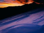Sastrugi (wind-carved snow) and Longs Peak, Rocky Mountain National Park, Colorado