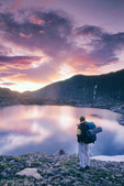 Glenn Randall watches the sunrise over Shelf Lake, near Estes Park, Rocky Mountain National Park, Colorado