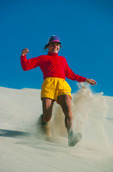 Cora Randall running down a sand dune, Kelso Dunes, East Mojave Desert, Mojave National Preserve, near Needles, California