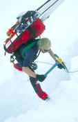 Dale Atkins crossing a crevasse at 15,000 feet, West Buttress, Mt. McKinley, Alaska
